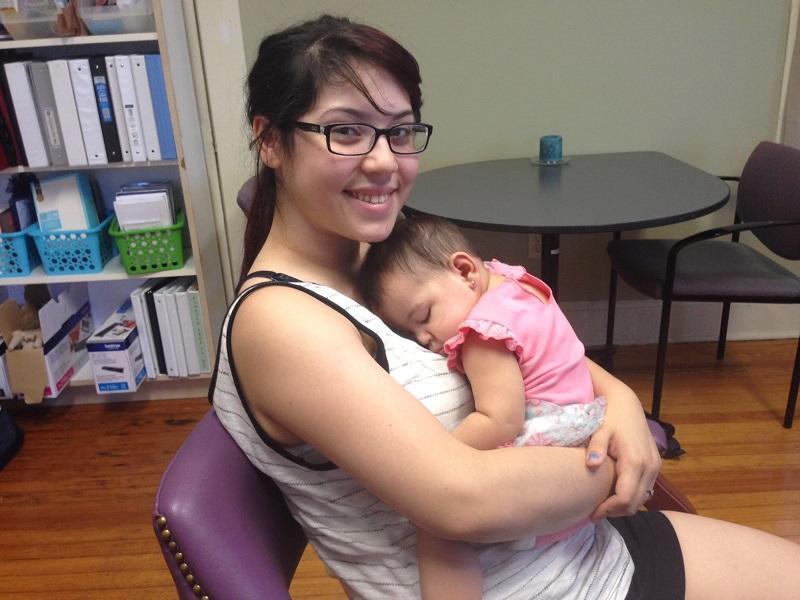 Natalie Gomez cradles her 6-month-old Aubrey.