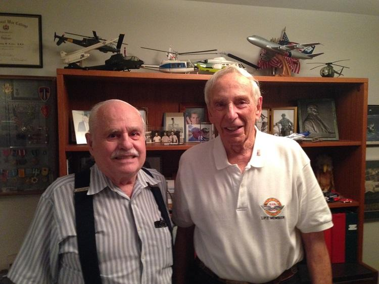 Bob Lawson and Sidney Achee pose with some of Sidney's military memorabilia