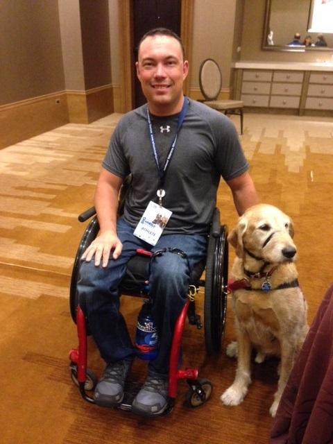 Tyler Wilson and his service dog.