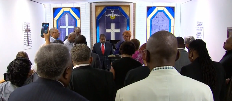 Church members gather during a vigil Thursday.