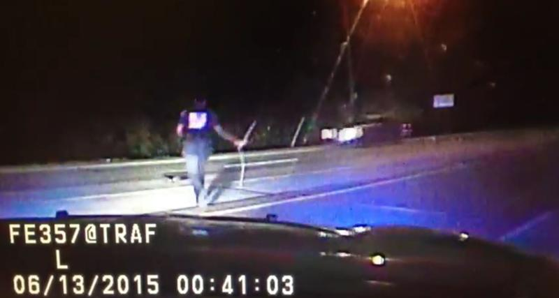 A police officer places a stop stick on the highway to slow down van driven by James Boulware.