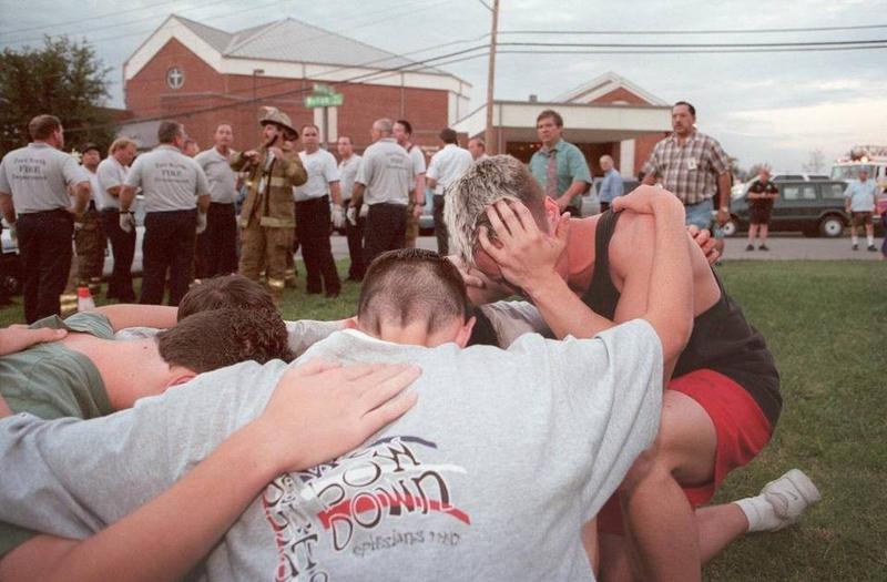 A group of young men praying outside Wedgwood Baptist Church in Ft. Worth in 1999 after the shooting inside the church.