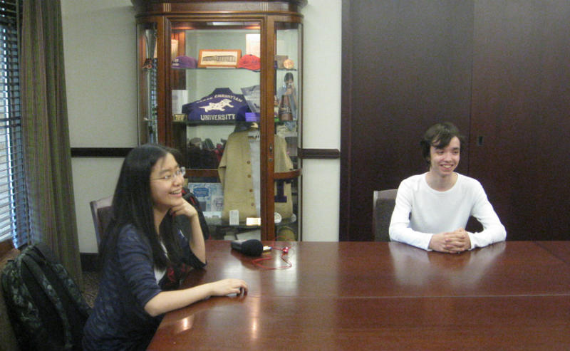 Teen pianists Youlan Ji (left) and Adam Balogh relax in a room at TCU. They're in Fort Worth for Piano Texas, the annual summer music performance and education festival. Both teens are also in the first Cliburn Jr. International Piano Competition