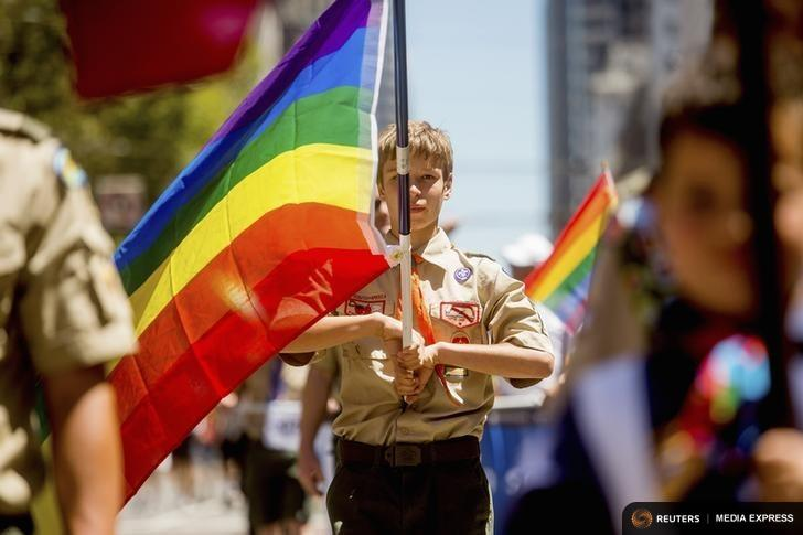 Boy Scout Casey Chambers carries a rainbow flag during the San Francisco Gay Pride Festival in California in 2014.