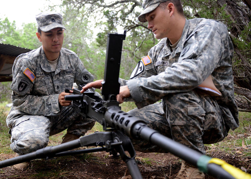 Staff Sgt. Lance Gerving demonstrates how to use the M2 .50-caliber machine gun to Staff Sgt. Fernando Medina last fall at a field training exercise at Camp Bullis, Texas.