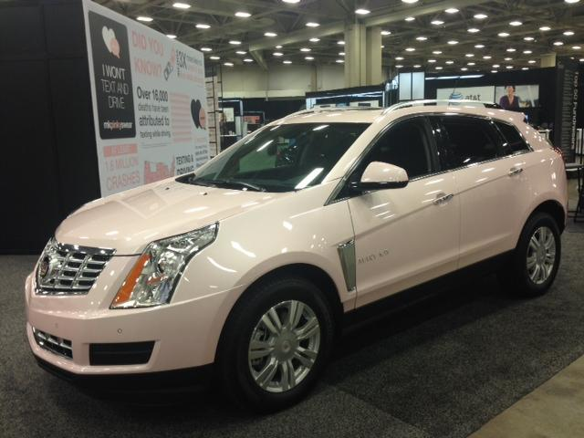 The newest pink Cadillac on display at the Mary Kay convention. Beauty consultants earn this by hitting sales goals and recruiting new consultants.