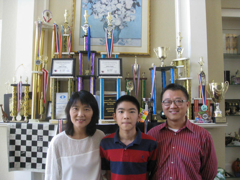 Jeffery the 14 year-old chess grandmaster with his mother and father at home in Coppell