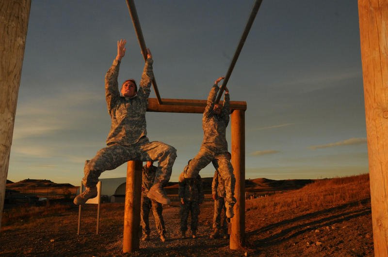 First Lt. Shaye Haver, left, works through an obstacle course during a Ranger Assessment at Fort Carson in 2014.