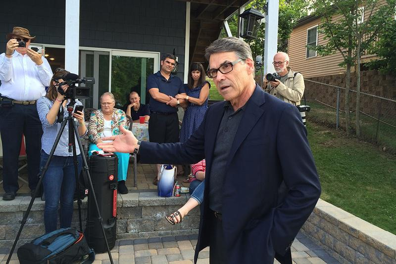 Rick Perry delivers his stump speech to Republican voters and activists at a lake house near Derry, New Hampshire, in July.
