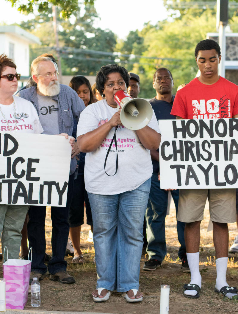 Demonstrators gathered in Arlington Monday night to protest the police shooting of Christian Taylor.