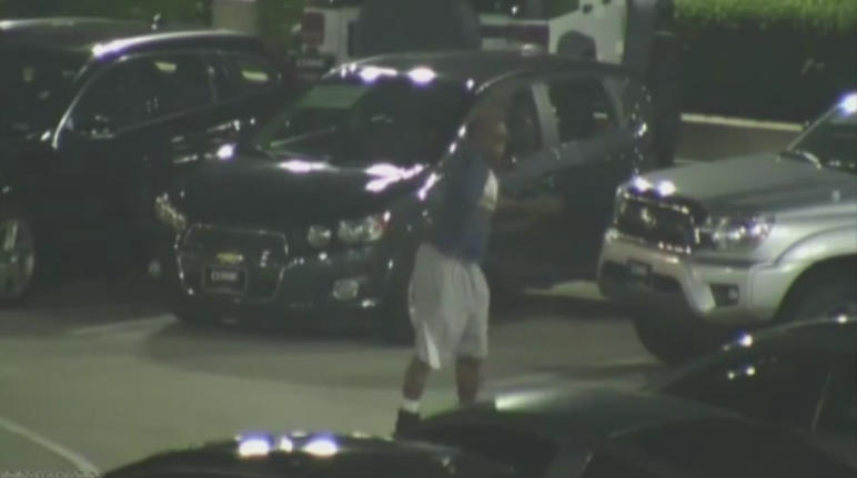 Surveillance footage released by Classic Buick GMC shows a teen breaking into an Arlington dealership