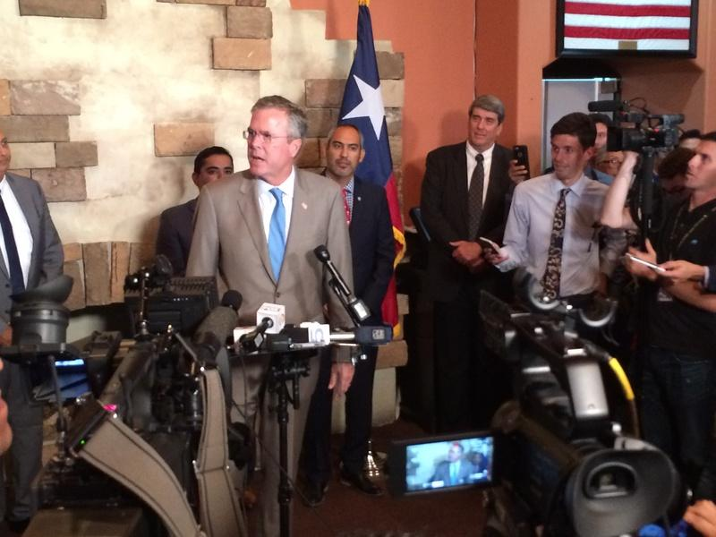 Former Florida Gov. Jeb Bush speaks with reporters Monday in McAllen. He brought his presidential campaign to the Rio Grande Valley for a fundraiser, briefing on border security with local officials and a stop at a Mexican restaurant.