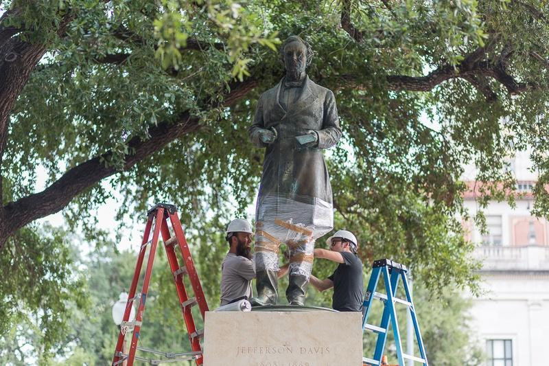 Workers prepared for the removal of the Jefferson Davis statue at the University of Texas at Austin Sunday morning.