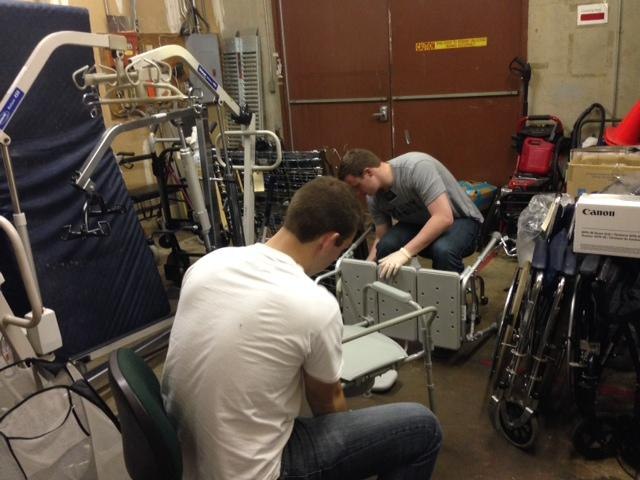 Volunteers sanitize equipment that's been donated to DME Exchange.