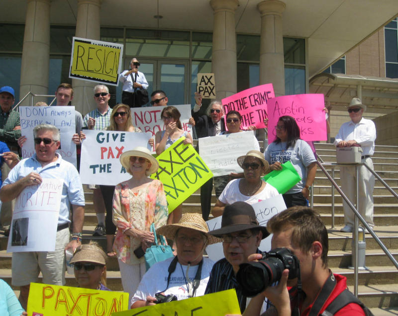 Protesters wanting  Attorney General Ken Paxton's resignation stacked the Collin County Courthouse steps Monday