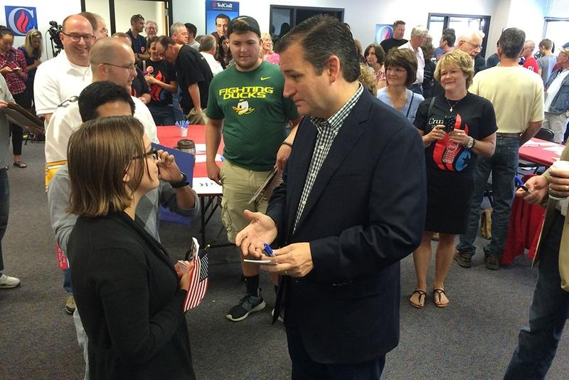 Presidential contender and U.S. Sen. Ted Cruz speaks with a supporter at the opening of his first Iowa office in Urbandale, Iowa, in September.