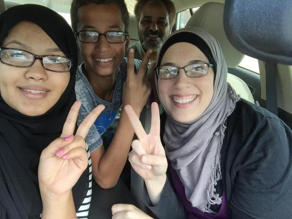 Ahmed Mohamed, center, was on his way to meet with an attorney earlier today.