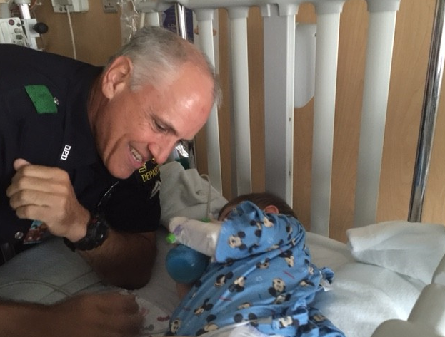 Dallas Senior Cpl. Matt Gnagi visited the boy he saved Monday at a hospital.