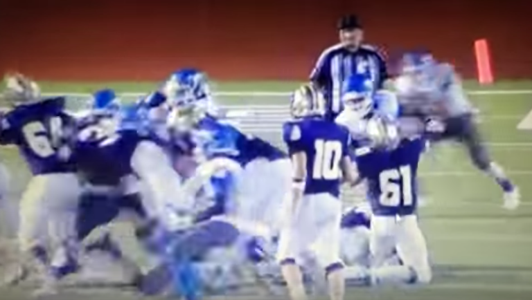 A screenshot from a video posted on YouTube shows the referee just before he was hit.