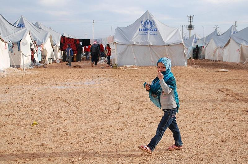 A child walks in a United Nations refugee camp in Turkey where thousands of Syrian refugees reside.