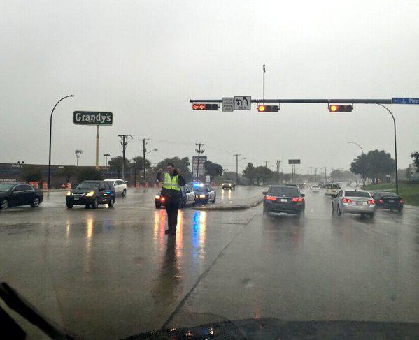 An Arlington police officer directed traffic Friday morning.