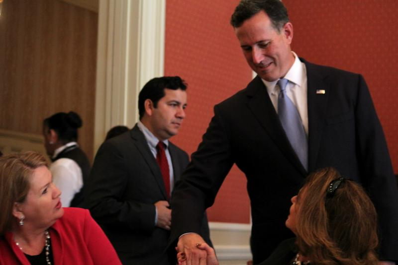 Rick Santorum greets the audience at the Fort Worth Club.