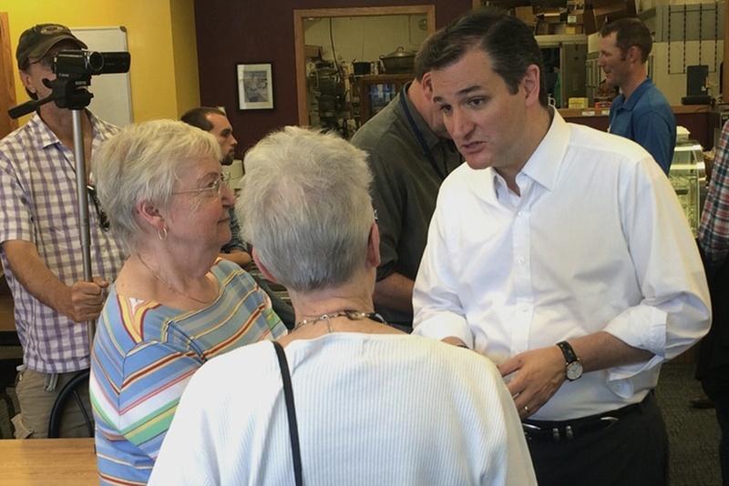U.S. Sen. Ted Cruz, R-Texas, talks to Iowans at a bakery in Orange City.