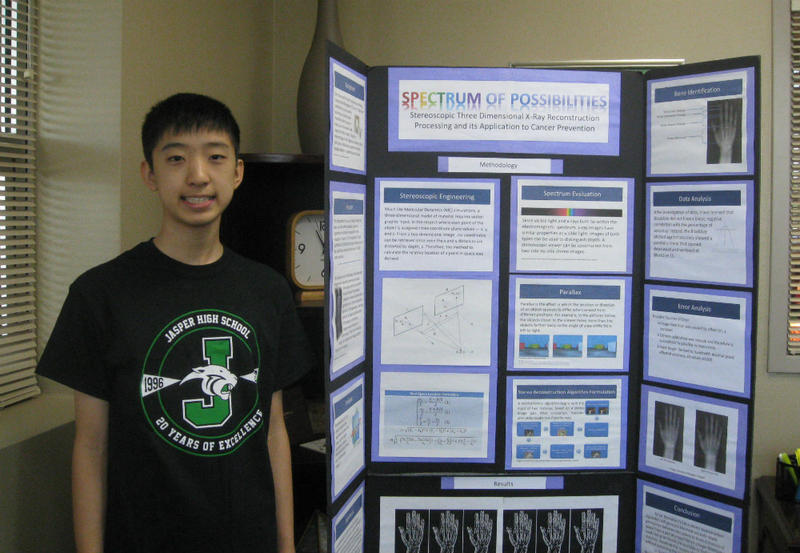 David Yue, 14, standing by his winning science fair presentation he created last year, in junior high. His project uses a pair of x-rays and his algorithm to create a 3D image.  That's without the radiation of a CT scan.