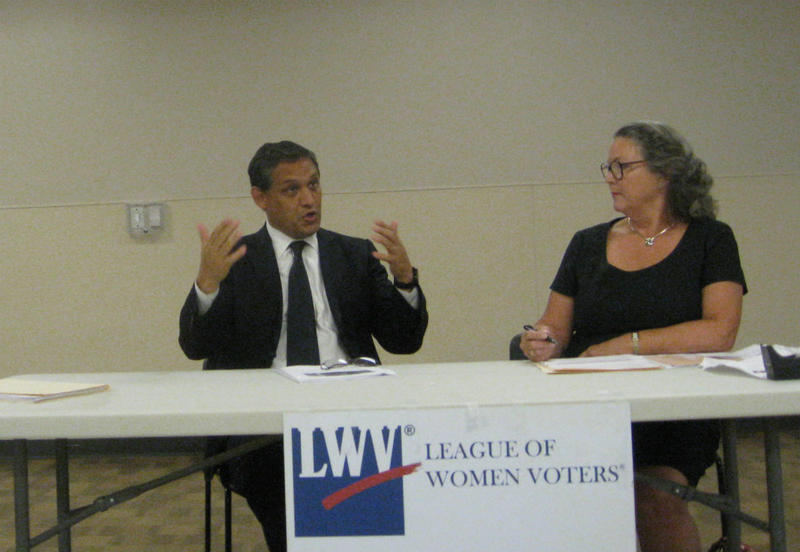 Dallas School Board member Edwin Flores answers questions about  the $1.6 billion bond proposal during a town hall meeting. League of Women Voters Vice President Susybelle Gosslee helped organize the meeting
