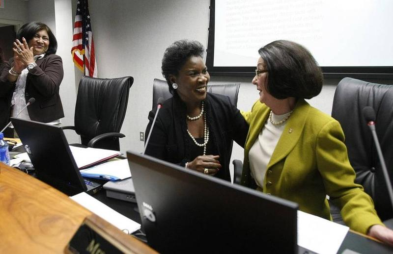 Erma Johnson Hadley, center, in 2010, when she was named chancellor of the Tarrant County College system.
