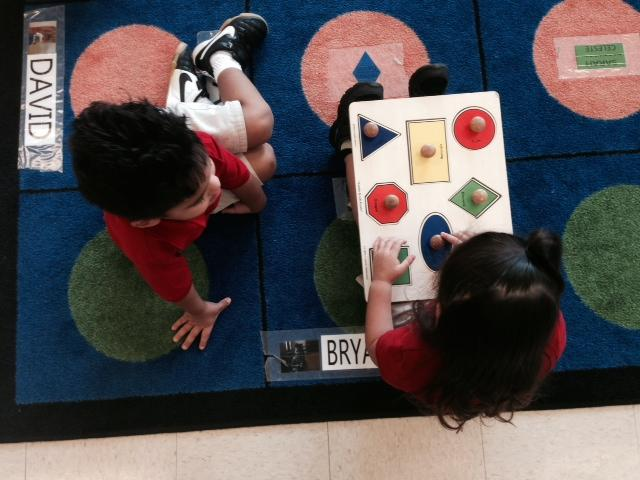 It's puzzle time in the 3-year-old class at the Momentous School.