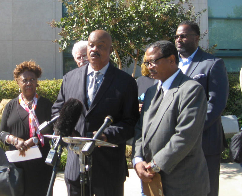 Rev. Ron Wright (lighter gray suit, front) helped lead groups against the Dallas school bond plan. Outside Dallas district headquarters. he's with Marion Barnett, Juanita Wallace and others.