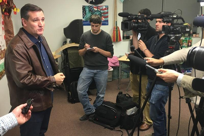 U.S. Sen. Ted Cruz speaks with reporters during an event in Iowa on Saturday.