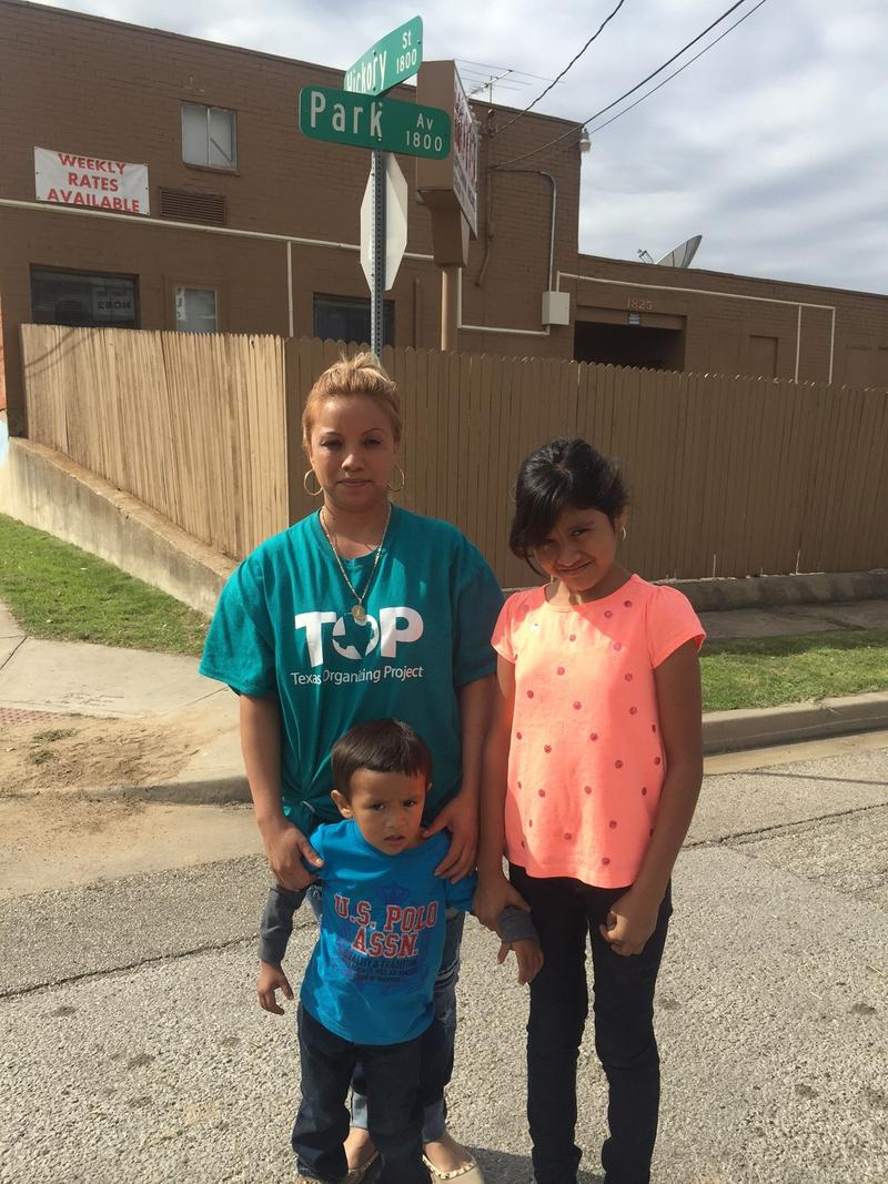 Ana Lucia Almanza stands with her children near the corner where a school bus stop was added after parents complained it wasn't safe for their children to walk to school.