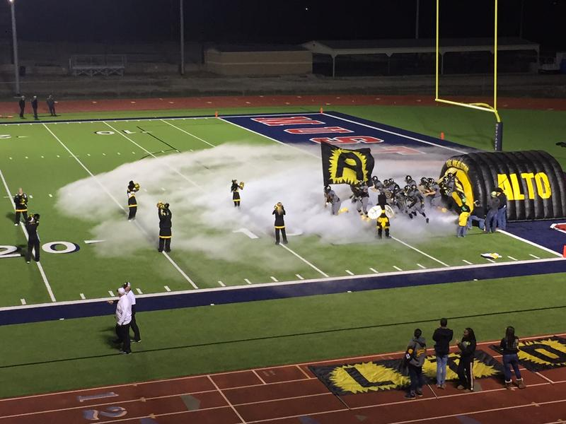 The Alto football team rushed onto the field for the first game of the 2015 playoffs.
