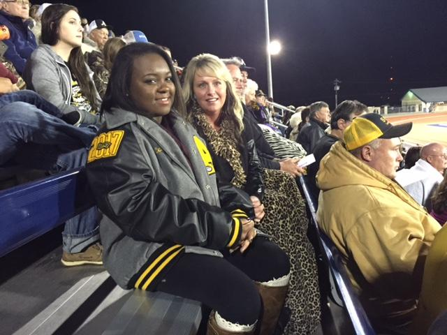 Paige Matthews, Cam'ron's sister, with family friend Kimberly Hinson at the Alto game in Madisonville, Texas on Nov. 13.