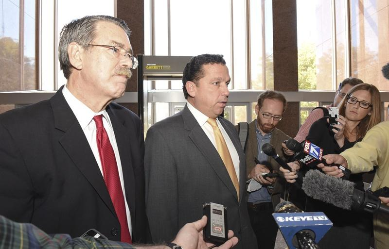 David Botsford, left, and Tony Buzbee, both defense lawyers for former Gov. Rick Perry, discuss Wednesday's hearing before the Texas Court of Criminal Appeals.