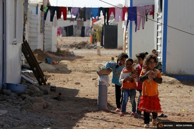 Syrian refugee children play near their families' residence at Al Zaatari refugee camp in Jordan, near the Syrian border.