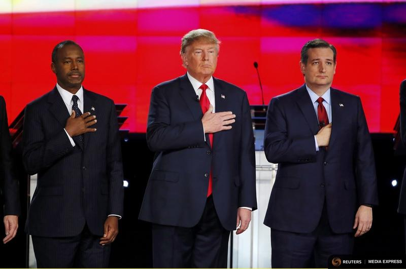 Republican U.S. presidential candidates Dr. Ben Carson, Donald Trump and Sen. Ted Cruz held their hands over their hearts before Tuesday night's debate.