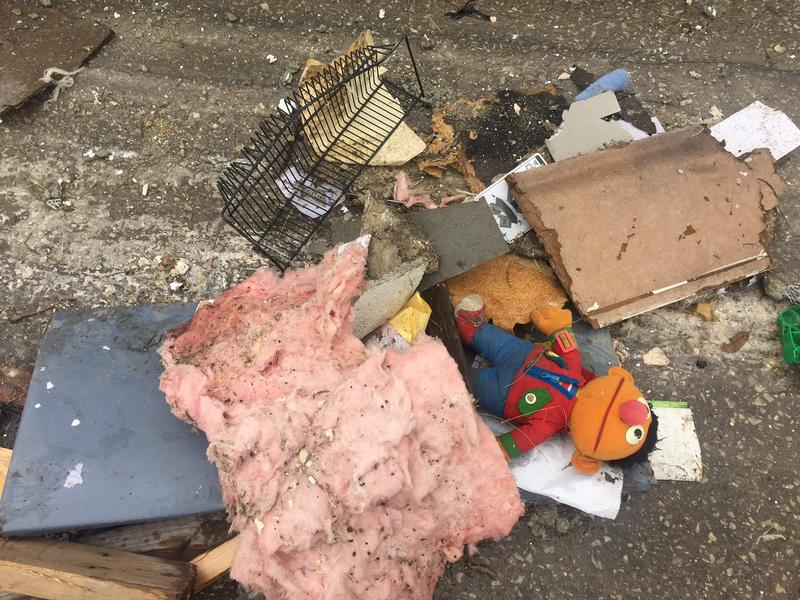 A child care center was among the businesses destroyed by the Collin County tornado. The debris included this doll of the character Ernie in Sesame Street.