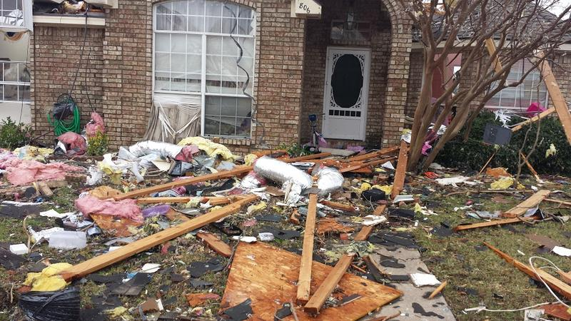 A front yard in Garland, which was hit hard by a tornado Saturday night.