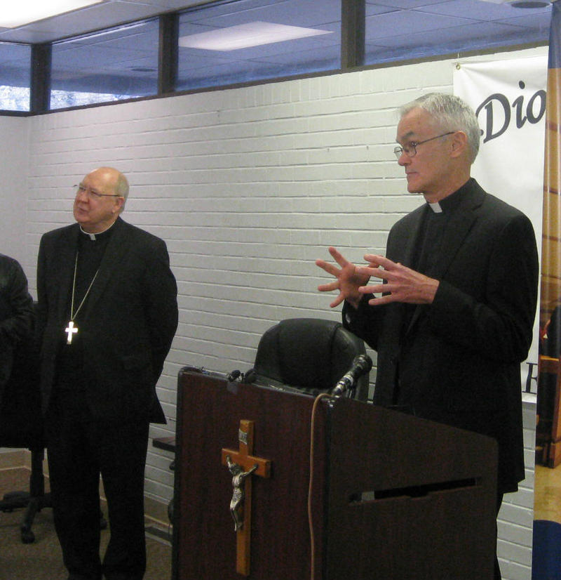 Newly named auxilliary bishop John Gregory Kelly, at the lectern, and Bishop Kevin Farrell talked with reporters Wednesday.