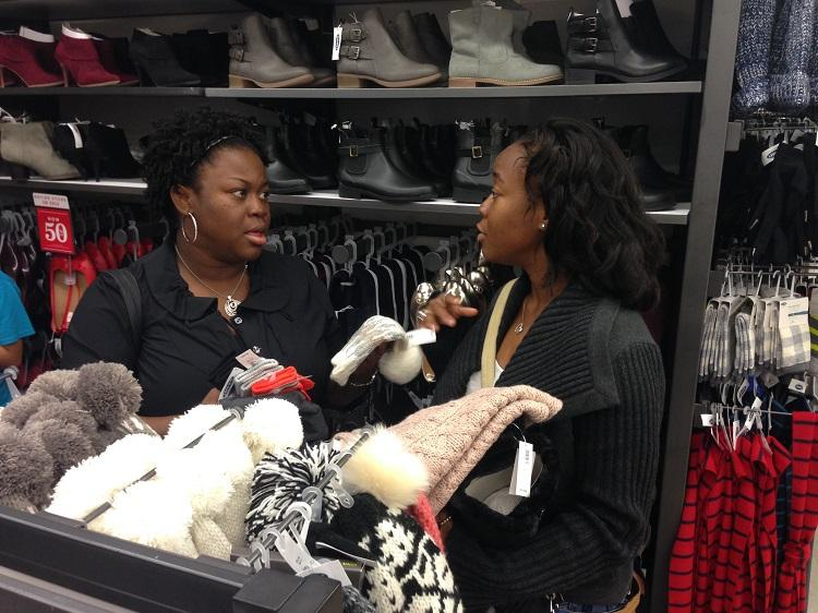 Tosha and her daughter Danielle shop for holiday gifts at Old Navy in Arlington.