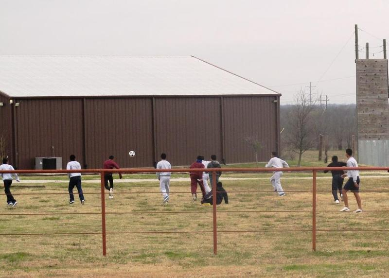 Teenage boys play soccer at Sabine Creek Ranch in Rockwall County. Nearly 200 children stayed at the temporary shelter.