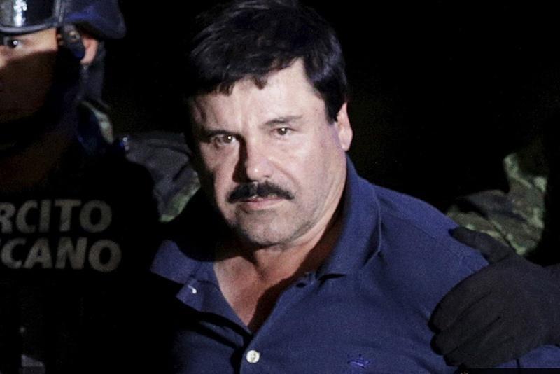 "Captured fugitive drug cartel leader Joaquin ""El Chapo"" Guzman is escorted by police in Mexico City last week."