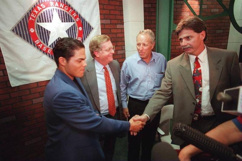 In this 1997 'Fort Worth Star-Telegram' photo, Rusty Rose, middle right, was a co-managing partner of the Rangers from 1989 to 1998 and worked closely with Tom Schieffer, middle left, and George W. Bush to transition the team into a big-market franchise.