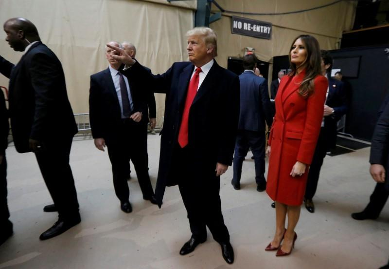 Donald Trump and his wife Melania arrive at a Republican caucus in Iowa Monday night.
