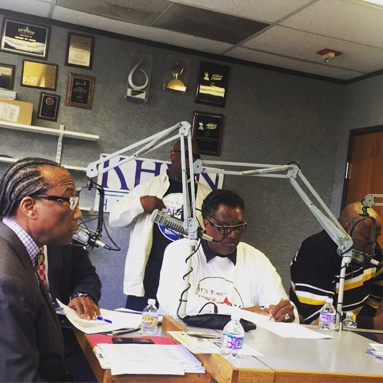 John Wiley Price, left, and Dwaine Caraway, center, appeared at a debate Monday at KHVN, a Dallas gospel radio station.
