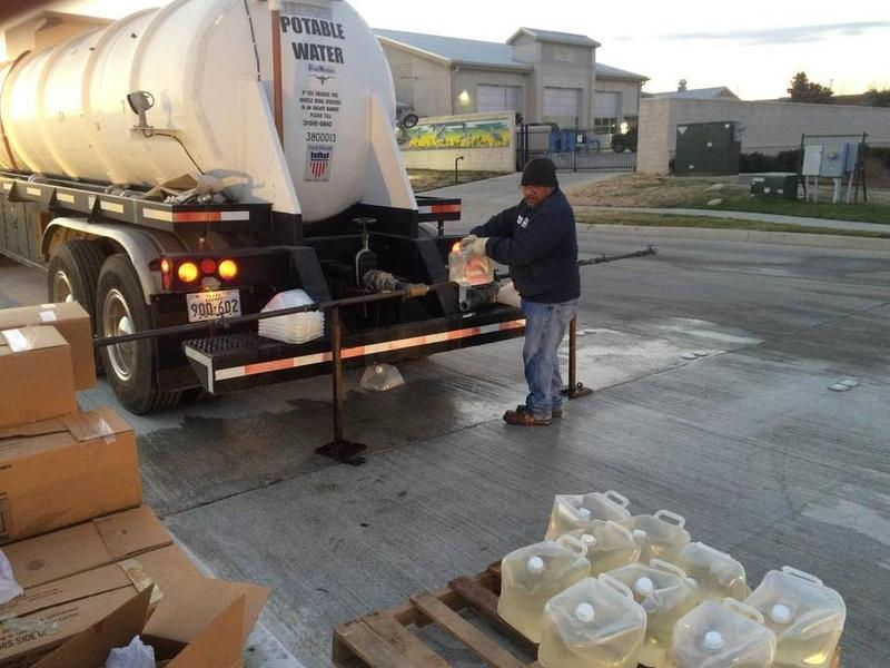 A worker unloads water from a truck in north Fort Worth.