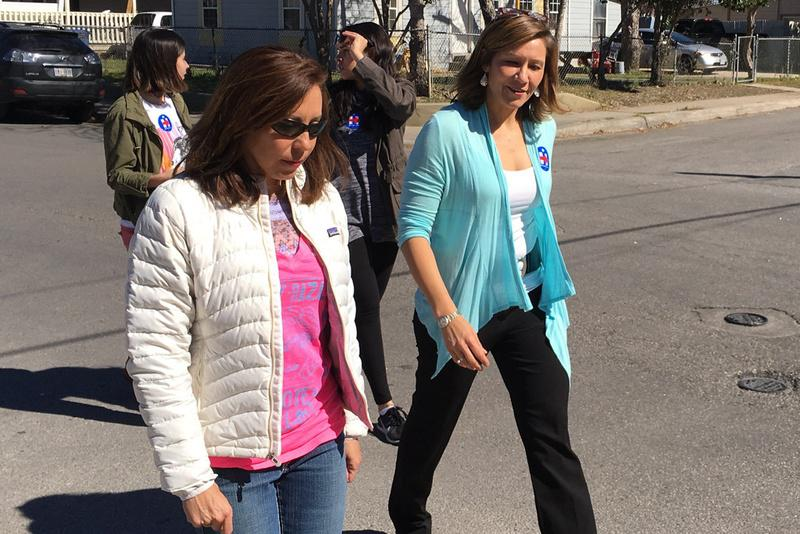 Hillary Clinton's national political director Amanda Renteria, at right, canvasses neighborhoods in San Antonio on Feb. 8.